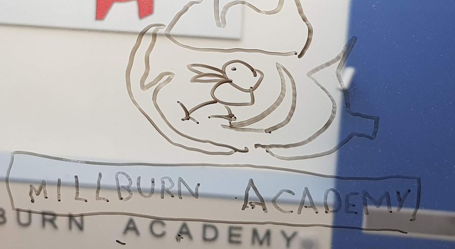 Millburn logo on glass
