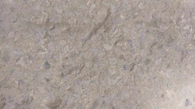 Crumbling and pitted concrete floor