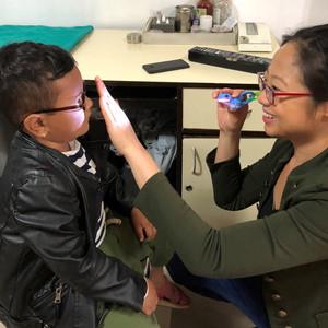 Examining a Child at Tilganga Eye Hospital in Nepal