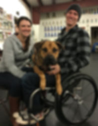 Vetern in wheelchair withservce dog and wife