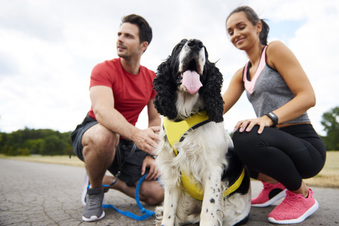 young-couple-and-dog-after-workout-on-th