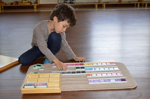Child working with color tablets.jpg