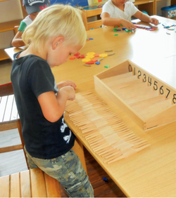 Child working with spindles.png