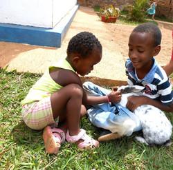 Children tending to rabbits.jpg
