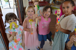 Girls smiling arts and crafts project.JPG