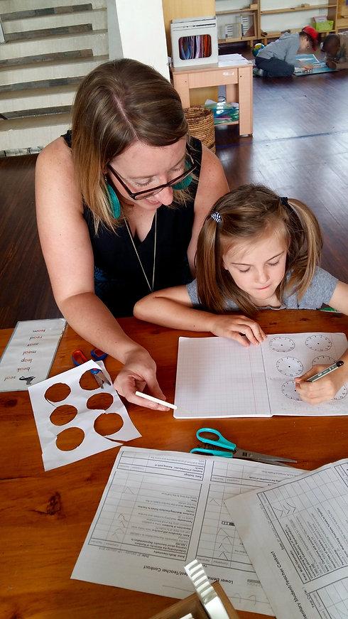Child and teacher writing.jpg