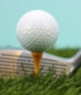 Golf Ball on Golf Tee with Golf Club