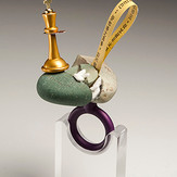 """""""That's how things work! #2""""  Ring   2014 Gold plated bronze, anodized aluminum, plastic, brass, acrylic paint, laser printer ink, and rock.  3""""(L) x 3"""" (W) x 4"""" (H)"""