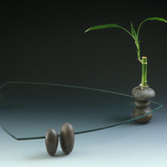 "Plate    2001 Glass, rock, silver, and lucky bamboo.  17.7"" (L) x 17.7""(W) x 9"" (H)"