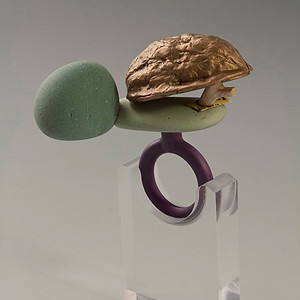 """""""Too smart for your own good #1"""" Ring   2013 Bronze, anodized aluminum, bird eye maple wood, and rock.  2.5""""(L) x 1.25"""" (W) x 2.5"""" (H)"""