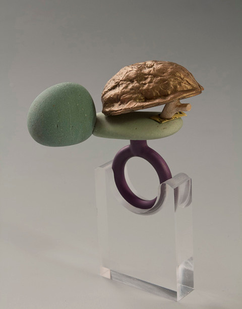 """Too smart for your own good #1"" Ring   2013 Bronze, anodized aluminum, bird eye maple wood, and rock.  2.5""(L) x 1.25"" (W) x 2.5"" (H)"