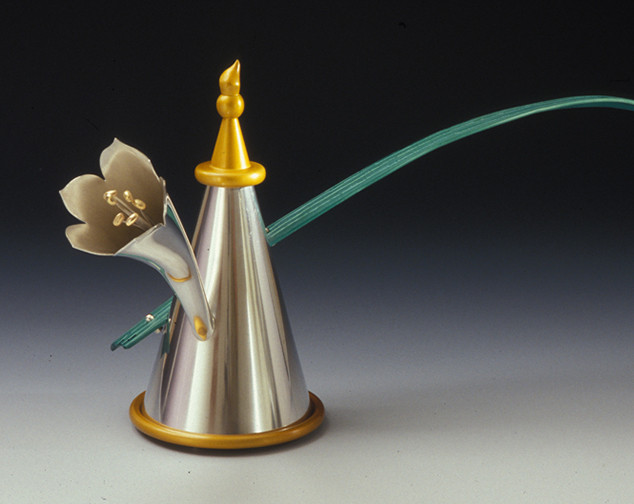 "Teapot 2004 Gold, silver, anodized aluminum, and cork.  13.4"" (L) x 3.9"" (W) x 7.3"" (H)."