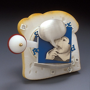 """""""Baby brooch""""  Brooch   2004 ABS plastic, silver, gold, anodized aluminum, lazertran transfer ink, laser printer ink, and acrylic paint.  3.1"""" (L) x 1.4"""" (W) x 3.3"""" (H)"""