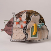 """""""Even rabbits crazy about money""""   Brooch   2017-8  Aluminum, maple, brass, enamel,  Delrin, acrylic ink, laser printer ink, and thread.        4.5"""" (L) x 1.25"""" (W)  x 3"""" (H)"""
