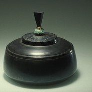 "Cast iron container        1990 Cast iron, bronze, and ebony.  6.7"" (diameter) x 6.7"" (H)"