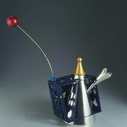 "Teapot 	2003-4 Gold, silver, stainless steel, and anodized aluminum.  8.3"" (L) x 5.5"" (W) x 7.1"" (H)."