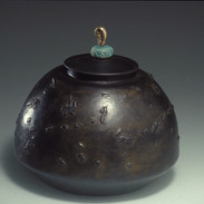 "Cast iron container        1990 Cast iron and bronze.  6.5"" (diameter) x 6.5"" (H)"
