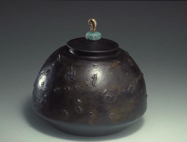 "Cast iron container        1990 Cast iron and bronze.  6.5"" (diameter) x 6.5"" (H)"