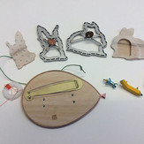 """""""Even rabbits crazy about money""""  (parts) Brooch   2017-8   Aluminum, maple, brass, enamel,  Delrin, acrylic ink, laser printer ink, and thread.        4.5"""" (L) x 1.25"""" (W)  x 3"""" (H)"""