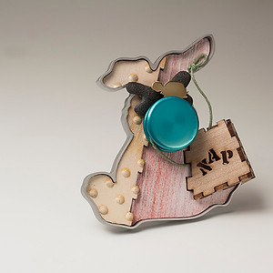 """""""The story never ended"""" Brooch  2016 Bronze, anodized aluminum,  bird eye maple wood, plastic, and cotton thread. 3.5""""(L) x 1"""" (W) x 3.5"""" (H)"""