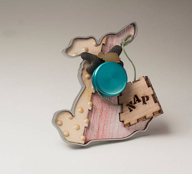 """The story never ended"" Brooch  2016 Bronze, anodized aluminum,  bird eye maple wood, plastic, and cotton thread. 3.5""(L) x 1"" (W) x 3.5"" (H)"