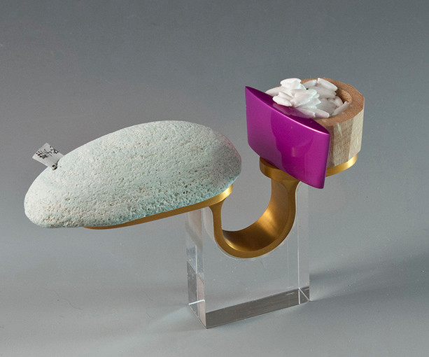 """Planning an idea"" Ring  2012 Anodized aluminum, maple wood, brass, Delrin, rock, acrylic paint, laser printer ink, and clear acrylic.  3.7""(L) x 1.1"" (W) x 4.5"" (H)"