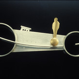 """Untitled Brooch         1992 Silver and gold-plated.  4.1"""" (L) x 0.25"""" (W) x 1.4"""" (H)"""