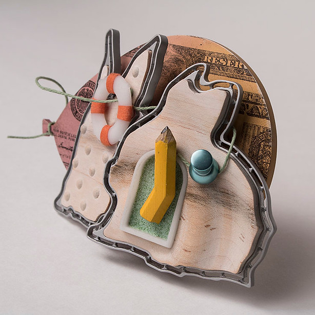 """Even rabbits crazy about money""  (side view) Brooch   2017-8  Aluminum, maple, brass, enamel,  Delrin, Acrylic ink, laser printer ink, and thread.        4.5"" (L) x 1.25"" (W)  x 3"" (H)"