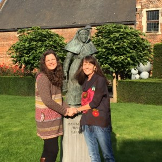 My retreat partner Susan and I with a statue of a Beguine.
