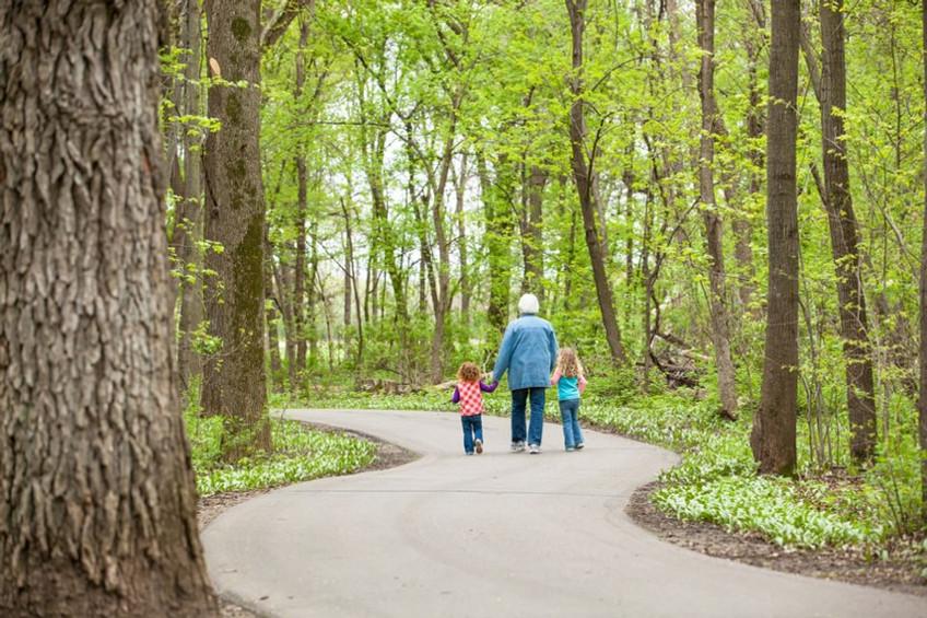 Girls & Grandma Walking Through Woods