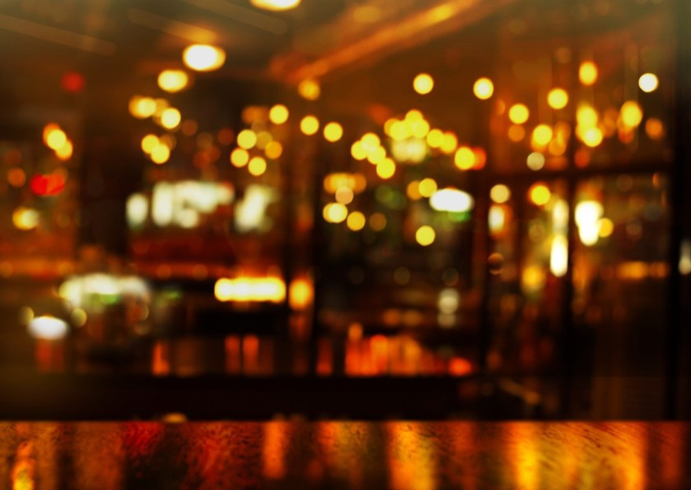 top of wood table and party light of bokeh in bar at night background