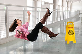 Young businesswoman falling on floor ins