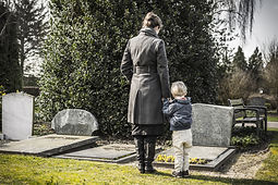 Woman with child at graveyard.jpg