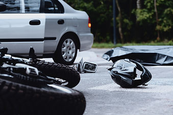 Motorcycle helmet on the street after a