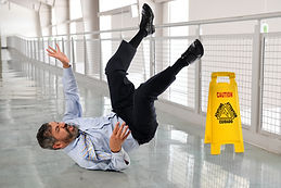 Hispanic businessman falling on wet floo