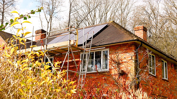 Domestic Solar system, installed in Mendip, with ISCAFF scaffolding surrounding the system and house.