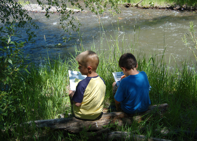 Boys sitting by Middle Creek