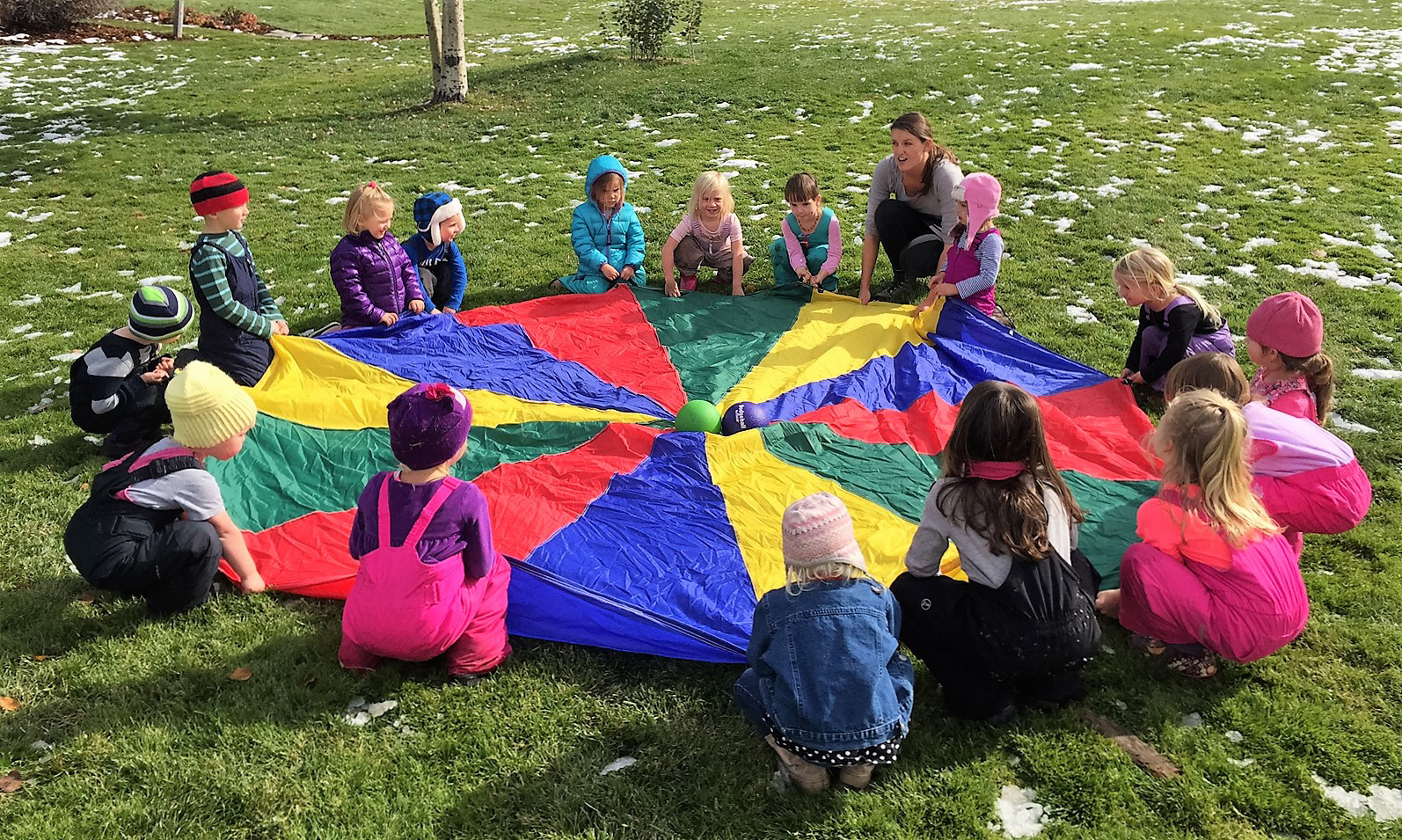 Children playing with a parachute