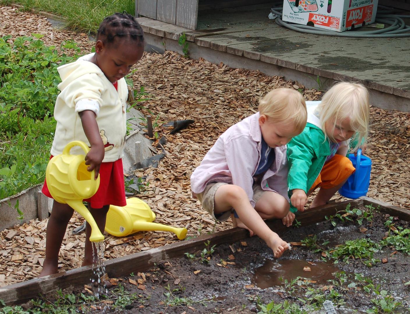 Girls watering our garden