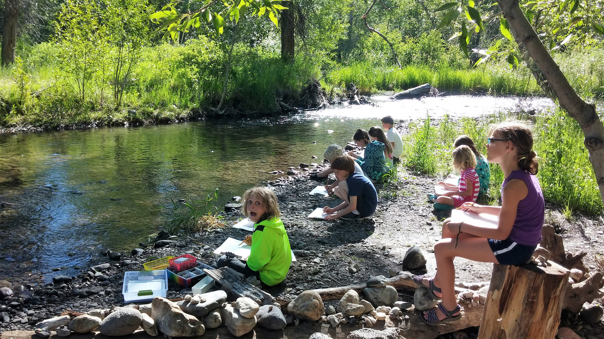 Students drawing the creek
