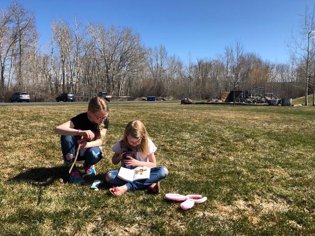 Girls reading outside