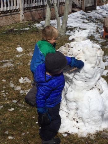 Boys building a snowman