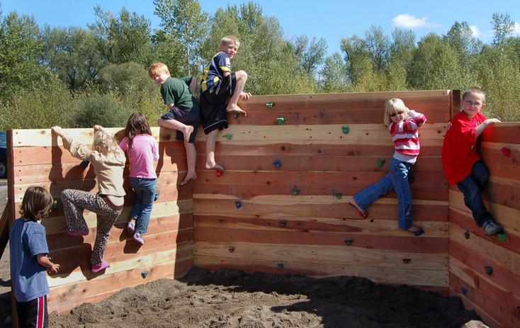 Children playing on the climbing wall