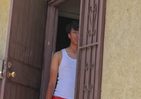 Brother looking out of the house.jpg