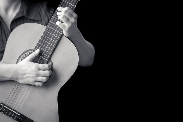 Acoustic guitar detail on black and whit