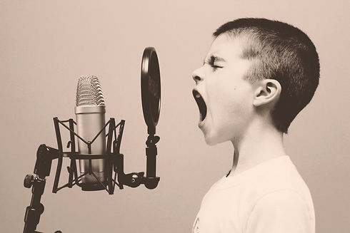 boy%20singing%20on%20microphone%20with%20pop%20filter_edited.jpg