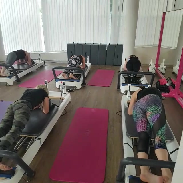 Henlu teaching Reformer Pilates in Zug, Switzerland