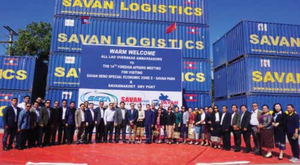 A group photo is taken with Mr Thongsavanh Phomvihane and delegates upon their arrival at the Savannakhet Dry Port on December 20.