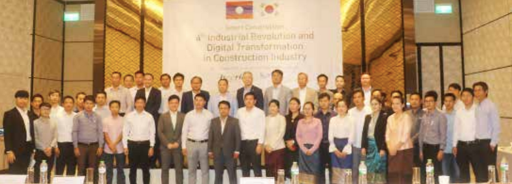 Officials and invited guests gather at the start of a talk on the construction industry, held in Vientiane on Tuesday