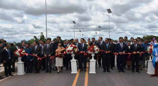 Lao and Japanese government representatives cut the ribbon to open two new bridges along National Road No. 9 in Savannakhet province.